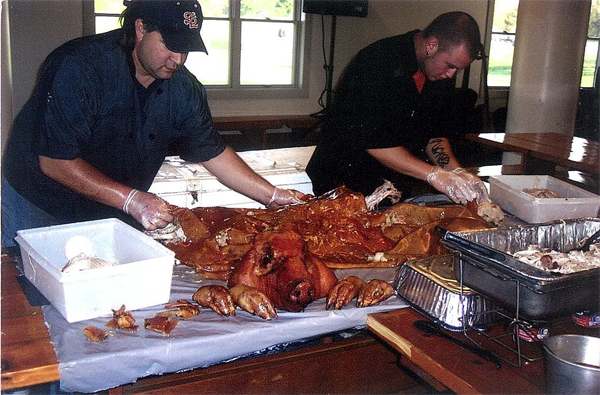 Caterers prepping fresh pork meat